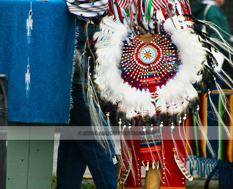 A Native American at the Healing Horse Spirit PowWow in Mt. Airy, Maryland sports a circular bustle of feathers on the back of his waist.
