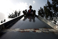 a young guest of a  small orphanage prepares to come down a slide in the orphanage's play ground in the outskirts of Addis Ababa, Ethiopia on Tuesday June 05 2007.