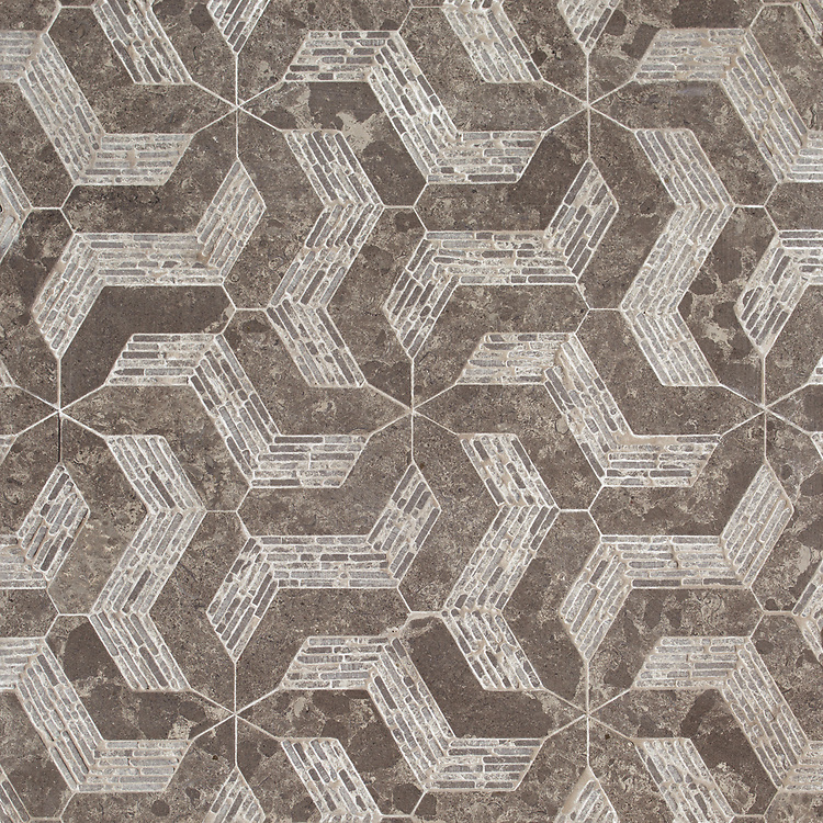 Nomad, a waterjet and hand-cut stone stone, shown in honed and tumbled Cavern, is part of the Miraflores Collection by Paul Schatz for New Ravenna.