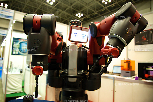 "The robot of Rethink Robotics ""Baxter"" performs at the Japan Robot Week 2014 on October 16, 2014 in Tokyo, Japan. Companies at the ""Japan Robot Week 2014"" exhibited their latest high-tech nursing and life supporting robots. The 2014 edition of the show ran from October 15 to 19 at Tokyo Big Sight. (Photo by Rodrigo Reyes Marin/AFLO)"