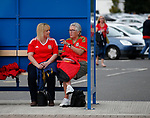 Two Welsh fans enjoy a chat in a bus stop close to the ground during the World Cup Qualifying Group D match at the Cardiff City Stadium, Cardiff. Picture date 2nd September 2017. Picture credit should read: Simon Bellis/Sportimage