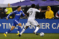 Ryan Smith (blue) takes on Clyde Simms...Kansas City Wizards defeated D.C Utd 4-0 in their home opener at Community America Ballpark, Kansas City, Kansas.