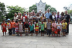 Members of Veterans for Peace have their picture made with a group of schoolchildren at Truong Son Martyrs Cemetery, in Quang Tri province, Vietnam. The cemetery contains the graves of about 10,300 communist soldiers who died along the Ho Chi Minh Trail supply network into South Vietnam during the conflict from 1959 to 1975. Veterans for Peace toured Vietnam in April to learn about efforts to mitigate the suffering of the country's Agent Orange victims and others who have been injured by bombs and land mines since the end of the war. April 24, 2013.