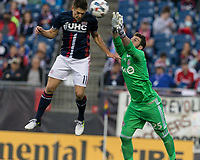 Foxborough, Massachusetts - June 3, 2017: First half action. In a Major League Soccer (MLS) match, New England Revolution (blue/white) vs Toronto FC (red), at Gillette Stadium.