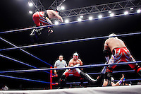 A Luchador (fighter) jumps from the ropes onto an opponent, held down by his team mates. Lucha Libre is a style of wrestling started in Mexico in 1933. The name means Free Fight, and matches tend to be focussed on spectacle and theatre with fans cheering for their favourite characters, who wear masks while jumping from the ropes, flipping opponents, and occasionally crashing into the crowd..©Jacob Silberberg/Panos/Felix Features.