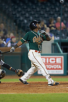 Isael Soto (15) of the Greensboro Grasshoppers follows through on his swing against the West Virginia Power at First National Bank Field on August 9, 2018 in Greensboro, North Carolina. The Power defeated the Grasshoppers 9-7 in game two of a double-header. (Brian Westerholt/Four Seam Images)