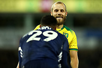 8th November 2019; Carrow Road, Norwich, Norfolk, England, English Premier League Football, Norwich versus Watford; Teemu Pukki of Norwich City smiles at Etienne Capoue of Watford as Watford win a free kick - Strictly Editorial Use Only. No use with unauthorized audio, video, data, fixture lists, club/league logos or 'live' services. Online in-match use limited to 120 images, no video emulation. No use in betting, games or single club/league/player publications