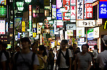 People walk through the main shopping and entertainments thoroughfare in the trendy neighborhood of Kichijoji in Musashino City,  Tokyo, Japan on 16 Sept. 2012.  Photographer: Robert Gilhooly