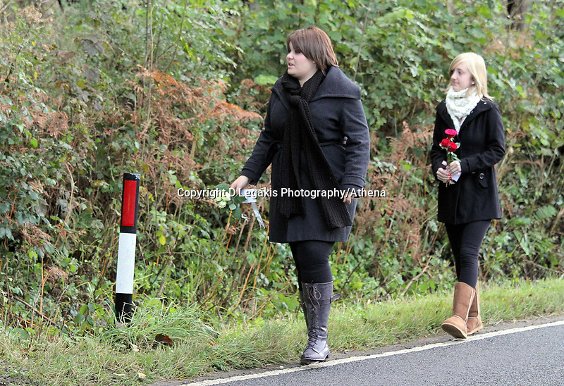 Pictured: Two young gilrs leaving floral tributes near the scene where the body of Rebecca Aylward was discovered. Monday 25 October 2010<br />