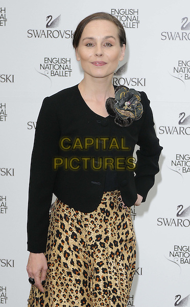 Tara Fitzgerald.English National Ballet Summer Party, Hyde Park, London, England..June 27th, 2012.half length black jacket blazer brown leopard print dress corsage hand on hip.CAP/CAN.©Can Nguyen/Capital Pictures.