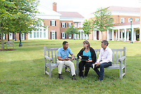 Darden executive Education Program participants talk in chairs on the lawn at the Darden School of Business at the University of Virginia in Charlottesville, VA. Photo/Andrew Shurtleff