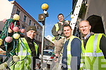Hanging the Christmas lights in Listowel on Friday were Danny Moriarty, John Costello, Connor Moriarty and Eugine Moriarty of Moriarty Electrical Contractors.
