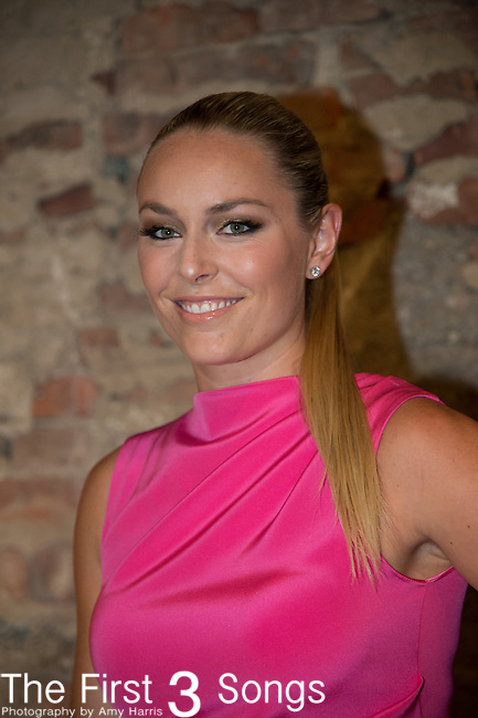 Professional ski racer Lindsey Vonn pose backstage at the Christian Siriano fashion show during Mercedes-Benz Fashion Week Spring 2015 at Eyebeam on September 6, 2014 in New York City.