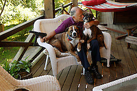 Richard Feldman, former National Rifle Association (NRA) lobbyist, now President of the Independent Firearm Owners Association pictured at his home in Rindge, New Hampshire with his dogs Stanley and Stella, July 3, 2015. to go with story by Nick O'Malley photo by Trevor Collens