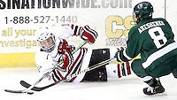 UNO's Zahn Raubenheimer tries to keep the puck away from Bemidji State's Jake Areshenko. Bemidji State beat UNO 4-2 Friday night during the first round of the WCHA playoffs at Qwest Center Omaha. (Photo by Michelle Bishop)