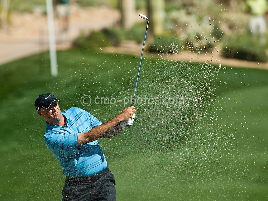 Mar 1, 2009; Marana, AZ, USA; Stewart Cink (USA) hits out of the bunker on the 11th hole during the final round consolation match of the World Golf Championships-Accenture Match Play Championship at the Ritz-Carlton Golf Club, Dove Mountain.