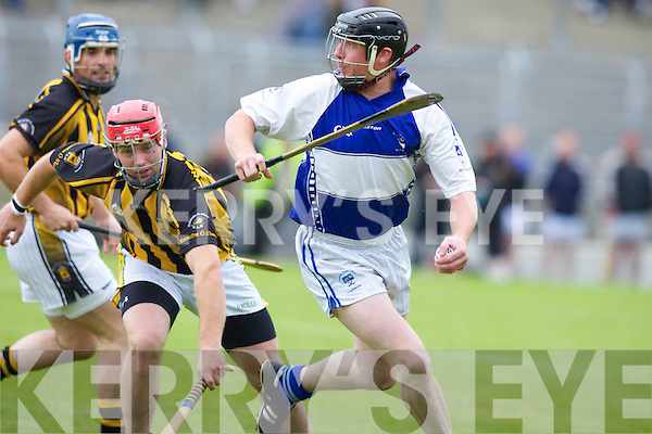 St Bremdan's John Paul Leen (captain) and Abbeydorney's Owen Egan.