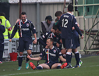 Sam Morrow on the ground celebrates his goal with teammates in the St Mirren v Ross County Clydesdale Bank Scottish Premier League match played at St Mirren Park, Paisley on 19.1.13.