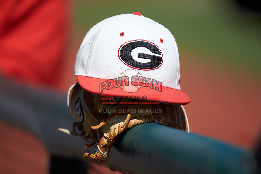 A Georgia Bulldogs cap sits on the dugout rialing prior to the game against the LSU Tigers at Foley Field on March 23, 2019 in Athens, Georgia. The Bulldogs defeated the Tigers 2-0. (Brian Westerholt/Four Seam Images)