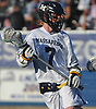 Garrett Gibbons #7 of Massapequa carries downfield during the Nassau County varsity boys lacrosse Class A semifinals against Port Washington at Shuart Stadium, located on the campus Hofstra University in Hempstead, on Thursday, May 24, 2018. He scored four goals in Massapequa's 11-3 win.