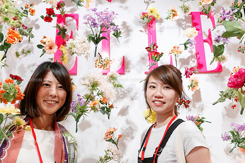 Visitors pose for a photograph during the //ELLE Women in Society// event on June 17, 2017, Tokyo, Japan. The annual event organized by ELLE Japon magazine aims to promote the significance of working women/s role in the Japanese society. The event features seminars with women from various career backgrounds including business, politics and music. International celebrities also participated to discuss women/s role in the global field. (Photo by Rodrigo Reyes Marin/AFLO)
