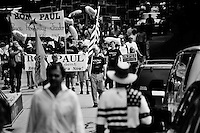 Supporters of Republican presidential candidate Ron Paul march in the 4th of July Parade in Amherst, New Hampshire. Republican presidential candidates Mitt Romney and Jon Huntsman walked in the parade as part of their campaign for the 2012 presidential election.
