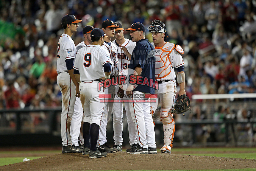 Head coach Scott O'Connor #26 of the Virginia Cavaliers talks to his team on the mound during Game 4 of the 2014 Men's College World Series between the Virginia Cavaliers and Ole Miss Rebels at TD Ameritrade Park on June 15, 2014 in Omaha, Nebraska. (Brace Hemmelgarn/Four Seam Images)