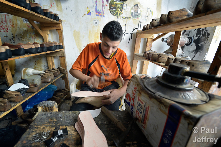A shoemaker works in the Zeitoun neighborhood of Gaza City, Gaza. Residents of the Palestinian territory are still reeling from the death and destruction of the 2014 war with Israel, and the continuing siege of the seaside territory by the Israeli military.