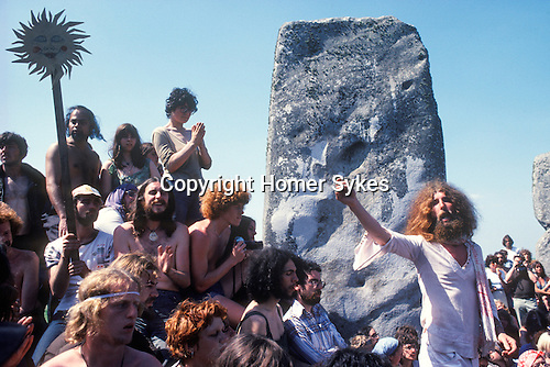 1970's style hippies attend the second free festival at Stonehenge to celebrate the summer solstice June 21st 1979. John Pendragon in white went on to run the Tribal Messenger magazine. He died in 1998.