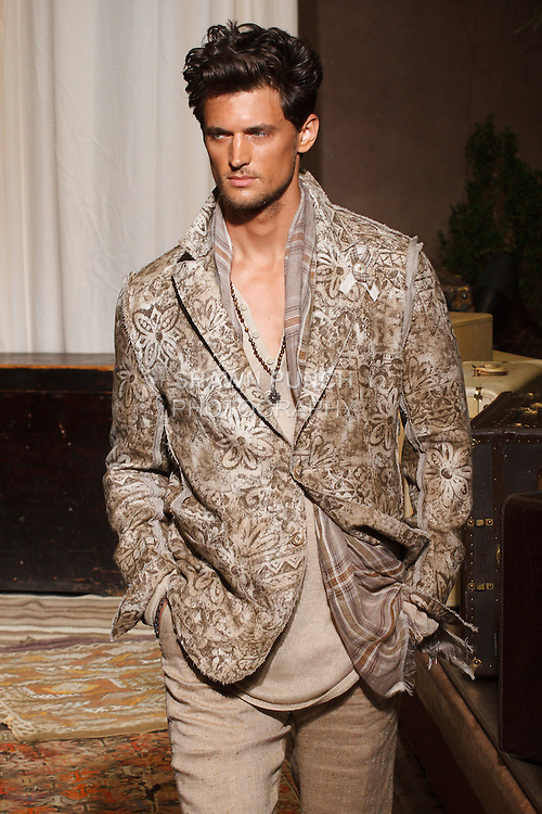 Model walks runway in an outfit from the Joseph Abboud Spring Summer 2017 collection, during New York Fashion Week Men's Spring Summer 2017.