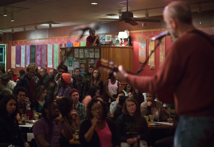 Bruce Darell performs on his guitar during a social justice-themed open mic night at Casa Nueva on Jan. 21, 2015. Photo by Lauren Pond