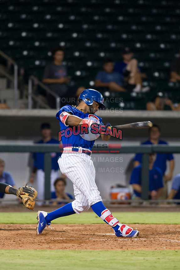 AZL Cubs right fielder Jonathan Sierra (22) follows through on his swing against the AZL Giants on September 6, 2017 at Sloan Park in Mesa, Arizona. AZL Giants defeated the AZL Cubs 6-5 to even up the Arizona League Championship Series at one game a piece. (Zachary Lucy/Four Seam Images)