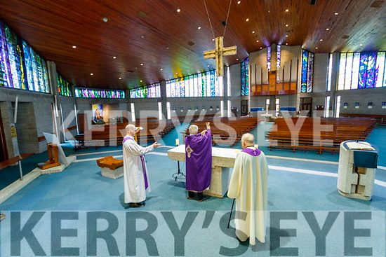 Fr Padraig Walsh, Fr Mario Jachym and Fr Niall Geaney celebrate Mass at St Brendan's Church, Tralee with no congregation present.
