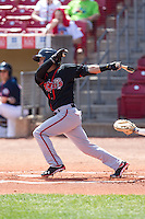 Lansing Lugnuts shortstop Jorge Flores #22 bats during a game against the Cedar Rapids Kernels at Veterans Memorial Stadium on April 30, 2013 in Cedar Rapids, Iowa. (Brace Hemmelgarn/Four Seam Images)