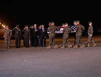 Members of the Official Party, including Governor John Carney (Democrat of Delaware), Sergeant Major of the United States Marine Corps Ronald Green, US Marine Corps General Robert B. Neller, Commandant of the Marine Corps, acting US Secretary of Defense Patrick M. Shanahan, and US Air Force Colonel Matthew Jones, 436th Airlift Wing, Vice Commander, pay their respects as a US Marine Corps carry team participates in the Dignified Transfer of the transfer case containing the remains of United States Marine Corps Staff Sergeant Christopher A. Slutman at Dover Air Force Base in Dover, Delaware on April 11, 2019.  He died as the result of a road-side bomb in Afghanistan on April 8, 2019.  Staff Sergeant Slutman, a decorated 15 year veteran of the Fire Department of New York (FDNY), was married and had three children. Photo Credit: Ron Sachs/CNP/AdMedia