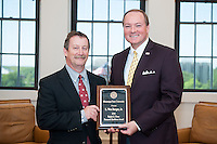 Wes Burger, left, the 2016 Ralph E. Powe Research Excellence Award honoree, is congratulated by MSU President Mark E. Keenum. Burger is associate director of the Mississippi Agricultural and Forestry Experiment Station, associate director of the Forest and Wildlife Research Center, Dale Arner Distinguished Professor of Wildlife Ecology, and Grisham Master Teacher in the Department of Wildlife, Fisheries and Aquaculture at Mississippi State. He has secured more than $19 million in research grants, and authored 229 publications including 89 peer-reviewed journal articles, 47 peer-reviewed proceedings articles, 14 book chapters, and 79 semi-technical bulletins and articles. In his current role, Burger works to define, develop and administer a broadly-based research program of national significance in agriculture and natural resources. The Powe Award is a memorial to the MSU alumnus and longtime research vice president who died in 1996.<br />