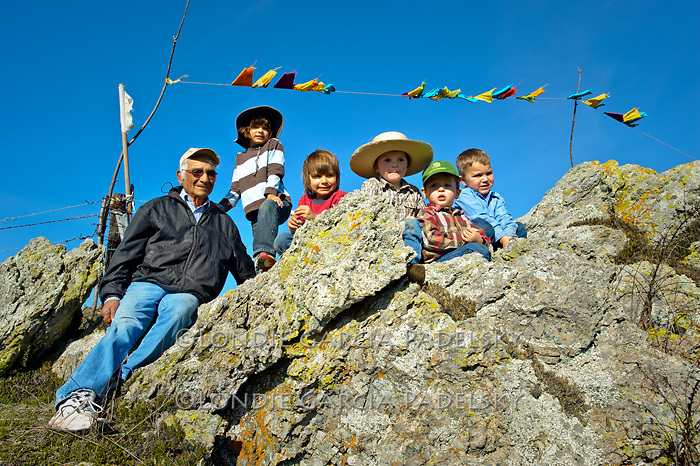 Grandpa Roy at the top of the mountain with the boys, San Luis Obispo, California.(Prayer flags mark the top of the mountain)