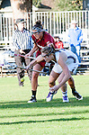 Los Angeles, CA 02/08/13 - Tanner Guarino  (Umass #15) and Erin Fitzgerald  (Northwestern #7) in action during the Northwestern vs UMass NCAA Women's Lacrosse game at USC's McAlister Field.