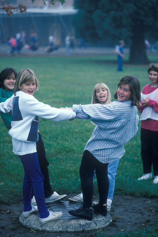 Fifth grade girls playing on school playground. Corvallis, Oregon