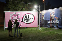 Visitors watch social issues themed billboards on display at the Arc Billboard social issues exhibition in Budapest, Hungary on Sept. 24, 2018. ATTILA VOLGYI