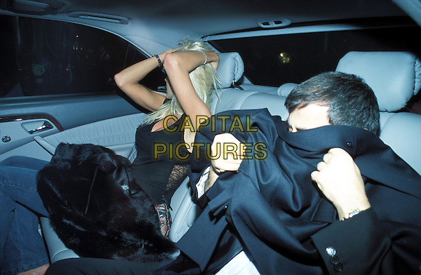 VICTORIA SILVSTEDT & mystery man leaving Chinawhite night club by taxi.Ref: AH.www.capitalpictures.com.sales@capitalpictures.com.©Capital Pictures.