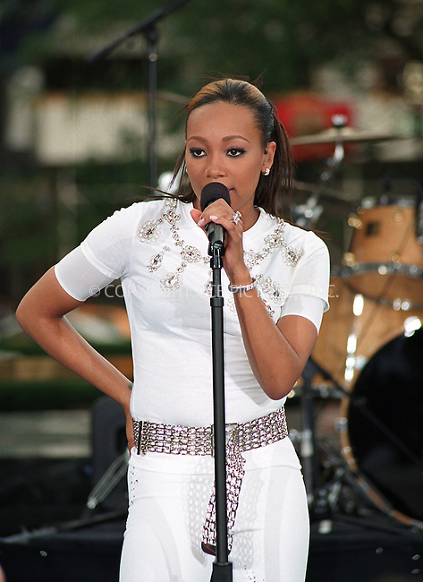 New singer MONICA performs at CBS Early Show in New York. July 30, 2002. REF: AMUS2099. Please byline: Anthony Moore/NY Photo Press.   ..*PAY-PER-USE*      ....NY Photo Press:  ..phone (646) 267-6913;   ..e-mail: info@nyphotopress.com