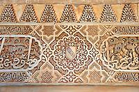 Moorish architectural sculpted plasterwork of the Palacios Nazaries, Alhambra. Granada, Andalusia, Spain.
