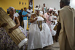 RIO DE JANEIRO, BRAZIL - JANUARY 24: Newly initiated practitioners obsessed by deities, or orixas,  during a candomble ceremony, in Rio de Janeiro, Brazil, on Saturday, Jan. 23, 2015. Brazil's Afro-Brazilian religions which in recent years have come under increasing threats and prejudice, particularly from the growing number of evangelical churches. Candombl&eacute; originated in Salvador, Bahia at the beginning of the 19th century when enslaved Africans brought their beliefs with them. Umbanda and candombl&eacute; are Afro-Brazilian religions practiced in mostly Brazil. <br /> (Lianne Milton for the Washington Post)