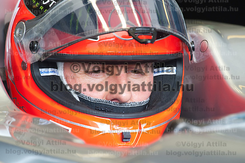 Mercedes Formula One driver Michael Schumacher of Germany sits in his car during the free practice session of the Hungarian F1 Grand Prix in Mogyorod (about 20km north-east from Budapest), Hungary. Thursday, 28. July 2011. ATTILA VOLGYI