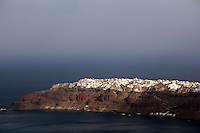 The village of Oia seen across the bay, Santorini, Greece