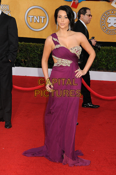 KIM KARDASHIAN.17th Annual Screen Actors Guild Awards held at The Shrine Auditorium, Los Angeles, California, USA..January 30th, 2011.SAG arrivals full length purple one shoulder cut out away side hand on hip gown long maxi dress gold beaded .CAP/ADM/BP.©Byron Purvis/AdMedia/Capital Pictures.