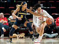 COLLEGE PARK, MD - DECEMBER 28: Kayla Robbins #5 of Michigan defends against Blair Watson #22 of Maryland. during a game between University of Michigan and University of Maryland at Xfinity Center on December 28, 2019 in College Park, Maryland.