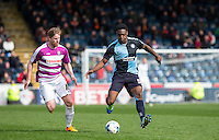 Anthony Stewart of Wycombe Wanderers heads away from Michael Gash of Barnet during the Sky Bet League 2 match between Wycombe Wanderers and Barnet at Adams Park, High Wycombe, England on 16 April 2016. Photo by Andy Rowland.