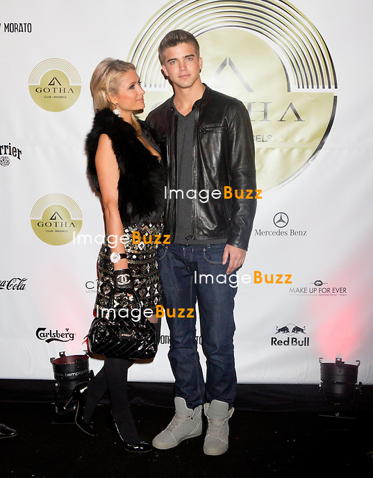 "PARIS HILTON & RIVER VIIPERI IN BRUSSELS - February 1st, 2013. Paris Hilton & boyfriend River Viiperi arrived from Madrid hat Brussels airport at 2pm, after spending a few days at the fashion week in Spain. The couple was invited by ex-Belgian football player Daniel Camus, for a huge party at the trendy club "" Gotha Club "" owned by the ex-football player and wife Alizée Poulicek, ex-Miss Belgium. A very tight security was surrounding Paris and River, including the police to escort them with two Mercedes SUV to their hotel suite location, kept very secret. The couple arrived at the Sheraton hotel in Downtown Brussels, located just across the Hilton hotel. Right after, a car arrived with with Paris & River's luggage, about 10 packed and destroyed suitcases. Rumors says that Paris received a huge amount of money to attend the party ( around 500,000 euros ). Before heading to the "" Gotha Club "", Paris and River enjoyed an amazing diner at the fanciest French cuisine restaurant in Brussels "" Villa Lorraine ""..Paris and River arrived by 1.30 am at the "" Gotha Club "" where a few hundreds of people were waiting for them..Paris and River partied until 4.30 am, enjoying lots of alcohol, "" Russian bubbles "" drinks, a mixed of Champagne and Vodka. The couple appeared to be very much in love and seemed to appreciate their very brief journey ( less than 24 hours ) during their first trip in Belgium. Paris and River left Brussels by noon on Satrurday, back to Los Angeles. Brussels, Belgium, February 1, 2013."